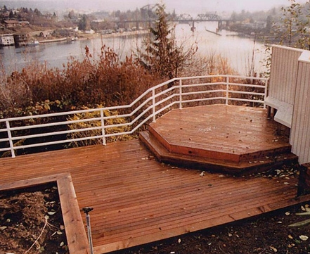 Custom deck and metal railing designed by Seattle landscaper, Environmental Construction