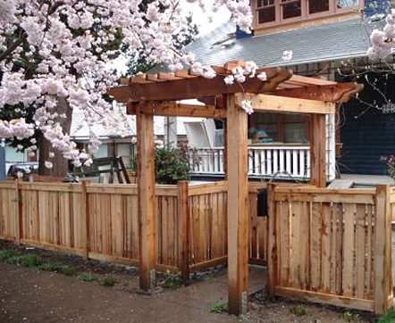 Fence and arbor designed by Seattle landscaper, Environmental Construction