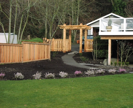 Backyard privacy fence built by landscape company, Environmental Construction