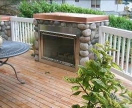 Fireplace on deck designed by Environmental Construction, Kirkland WA
