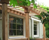 Pergola over windows provides partial shade