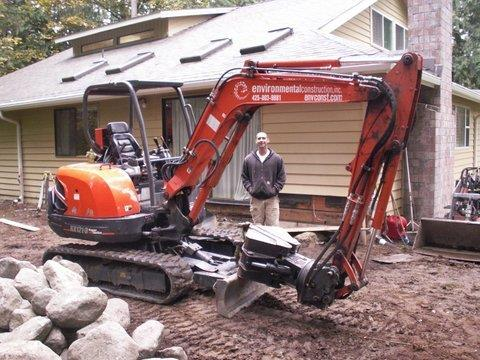 Trackhoe used by Environmental Construction landscape company