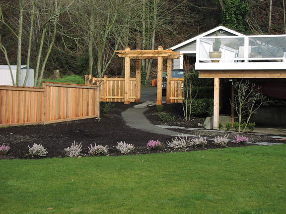 Pergola and wooden privacy fence