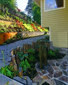 Rock fountain and colorful hillside add elegance to Mercer Island home.