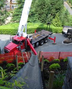 Backyard landscaping in Mercer Island requires heavy machinery to move top soil.