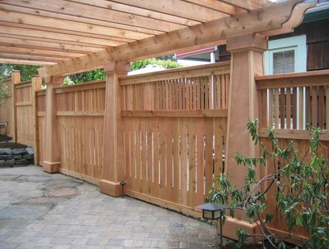 Fencing to enclose a patio designed by Environmental Construction Inc. in Kirkland WA