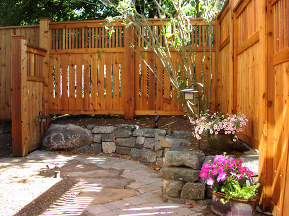 Fences with stained finishes designed by Environmental Construction Inc. in Kirkland WA