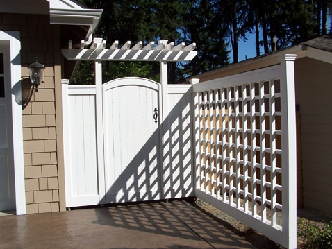 Gate, arbor, and privacy screen designed by Environmental Construction Inc. in Kirkland WA