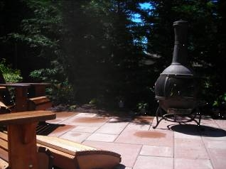 Portable firepot and patio designed by Environmental Construction Inc. in Kirkland WA