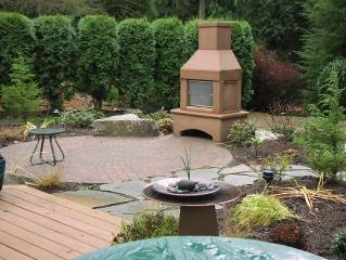 Fireplace on a patio designed by Environmental Construction Inc. in Kirkland WA