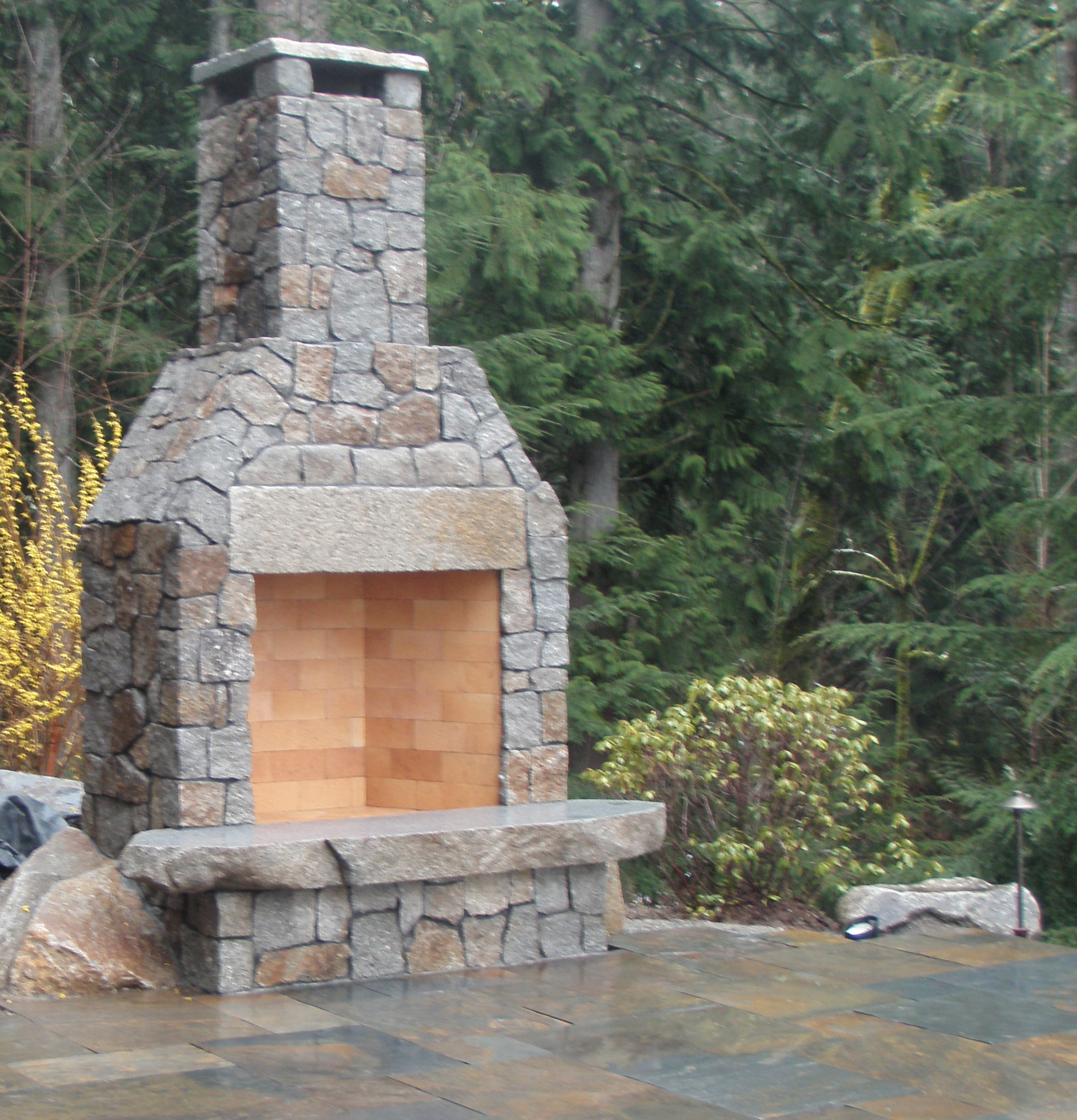 Stone fireplace designed by Environmental Construction Inc. in Kirkland WA