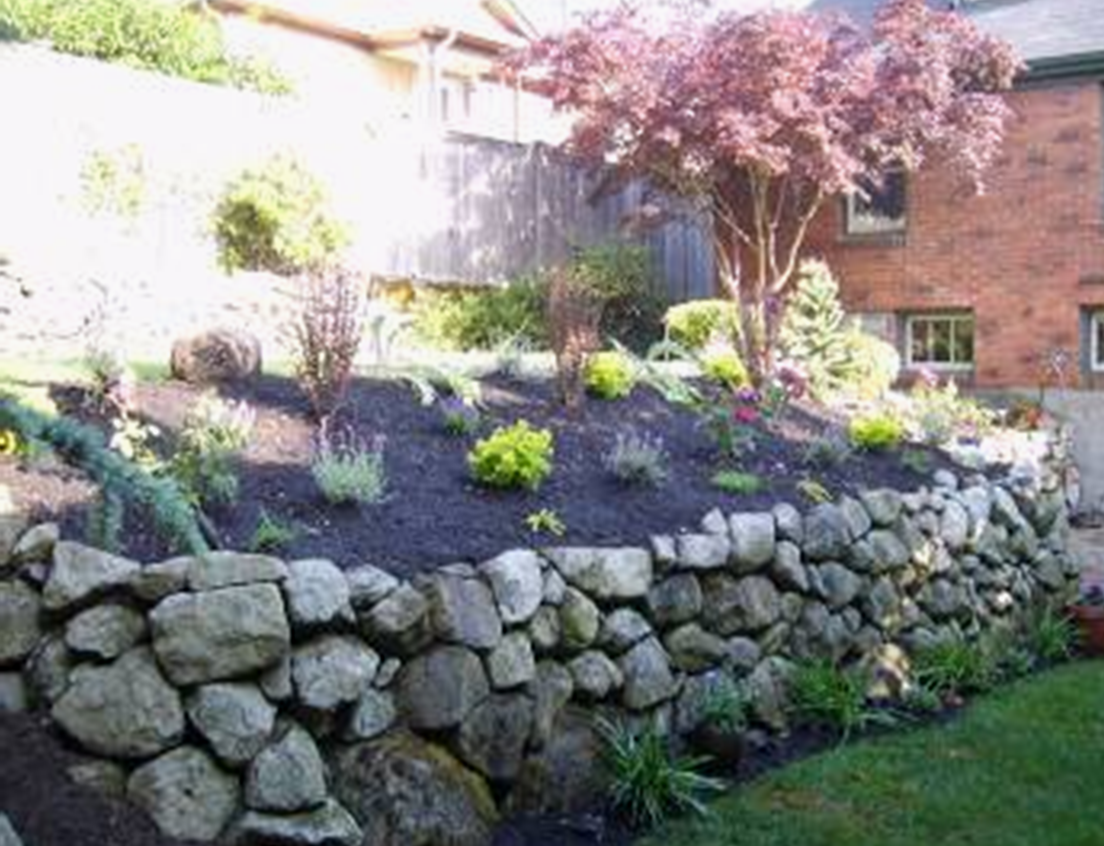 Rock retaining wall designed by Environmental Construction Inc. in Kirkland WA