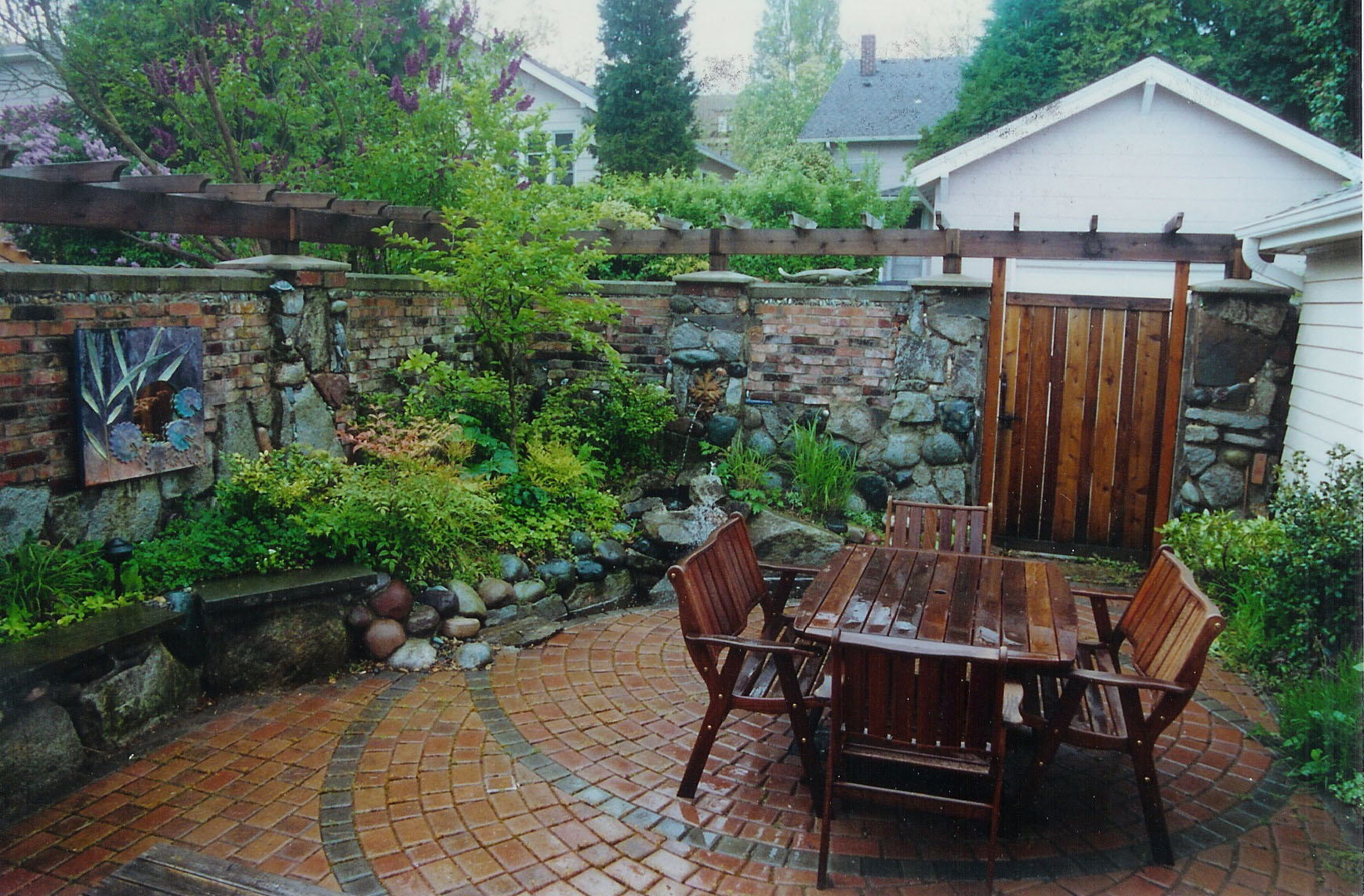 Brick and stone wall designed by Environmental Construction Inc. in Kirkland WA