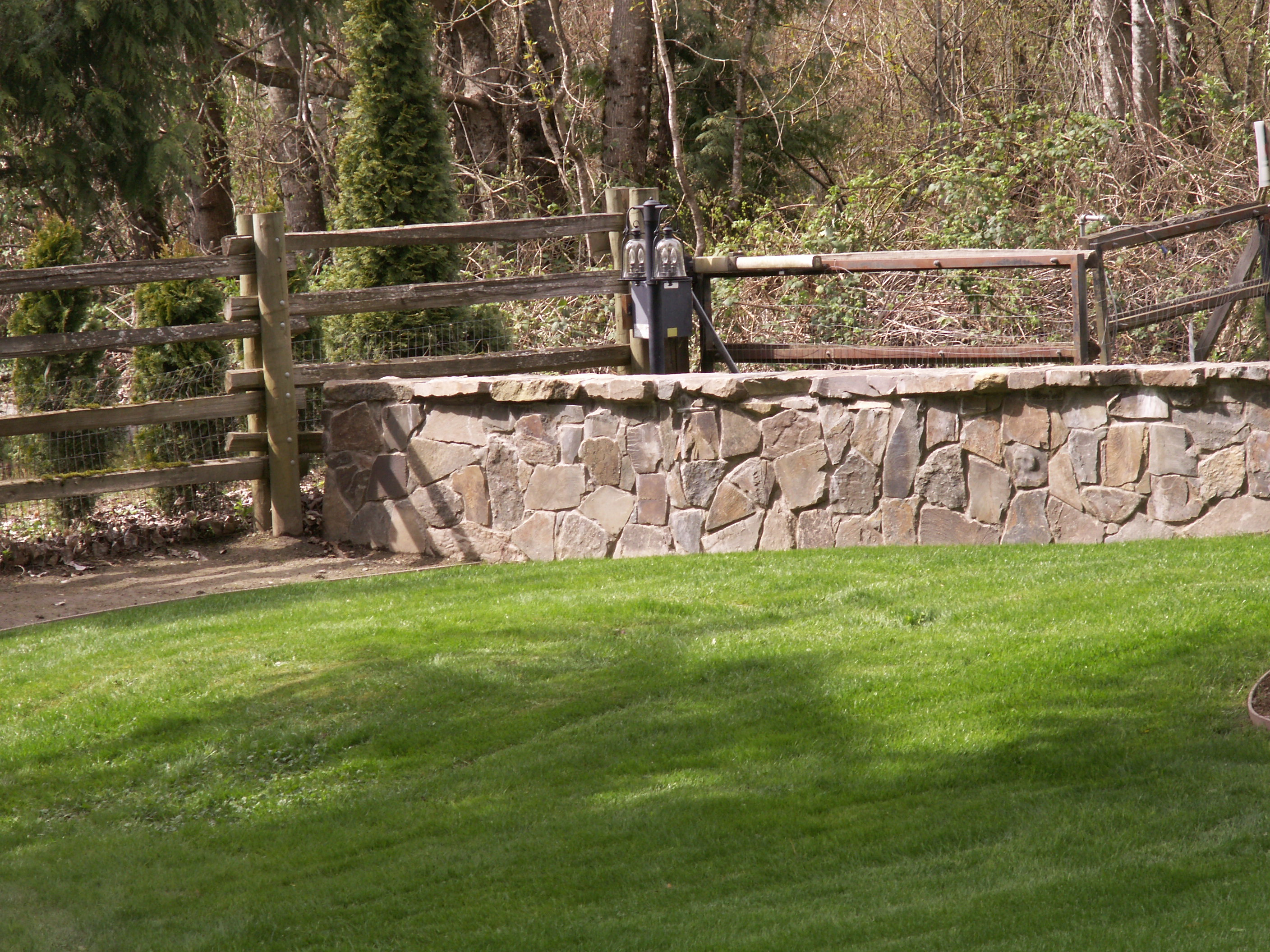 Cemented stone wall designed by Environmental Construction Inc. in Kirkland WA