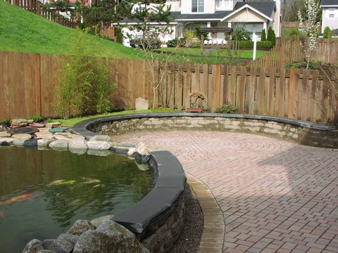 Wall for pond designed by Environmental Construction Inc. in Kirkland WA
