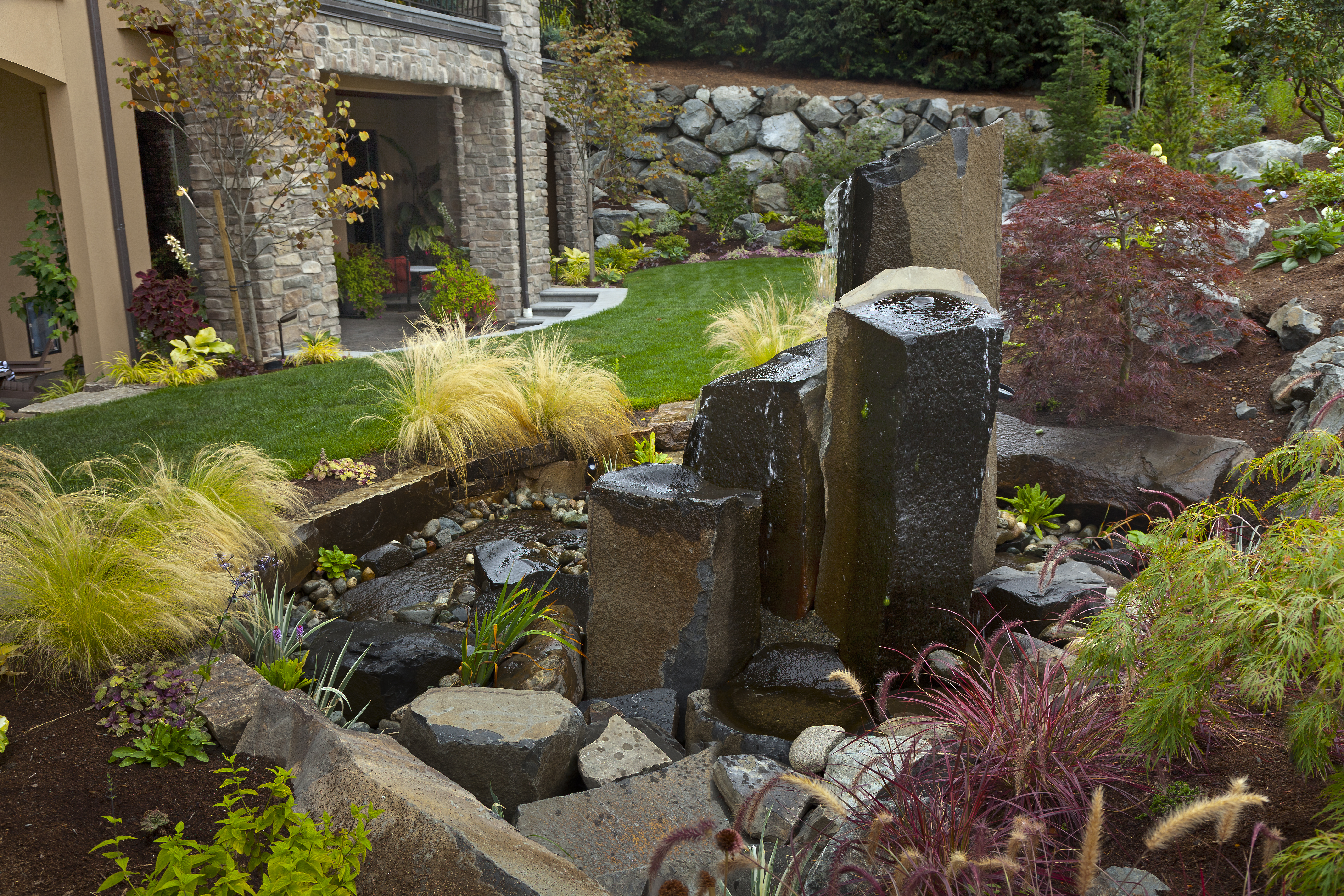 Fountain from a monolith designed by Environmental Construction Inc. in Kirkland WA