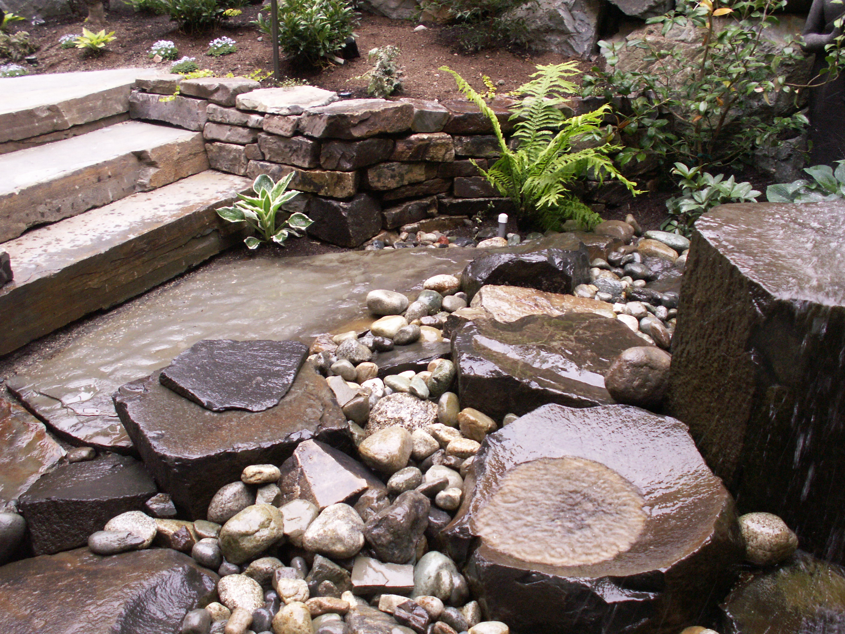Stone fountain designed by Environmental Construction Inc. in Kirkland WA