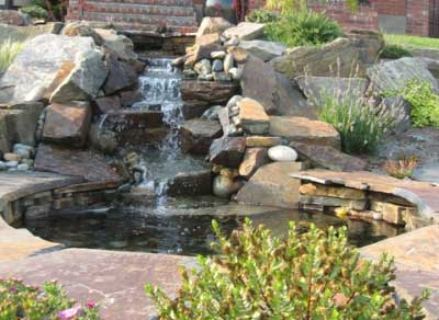 Waterfall over flagstone designed by Environmental Construction Inc. in Kirkland WA