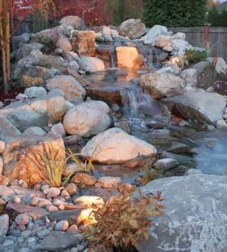 Water feature with outdoor lighting, designed by Environmental Construction, Inc.