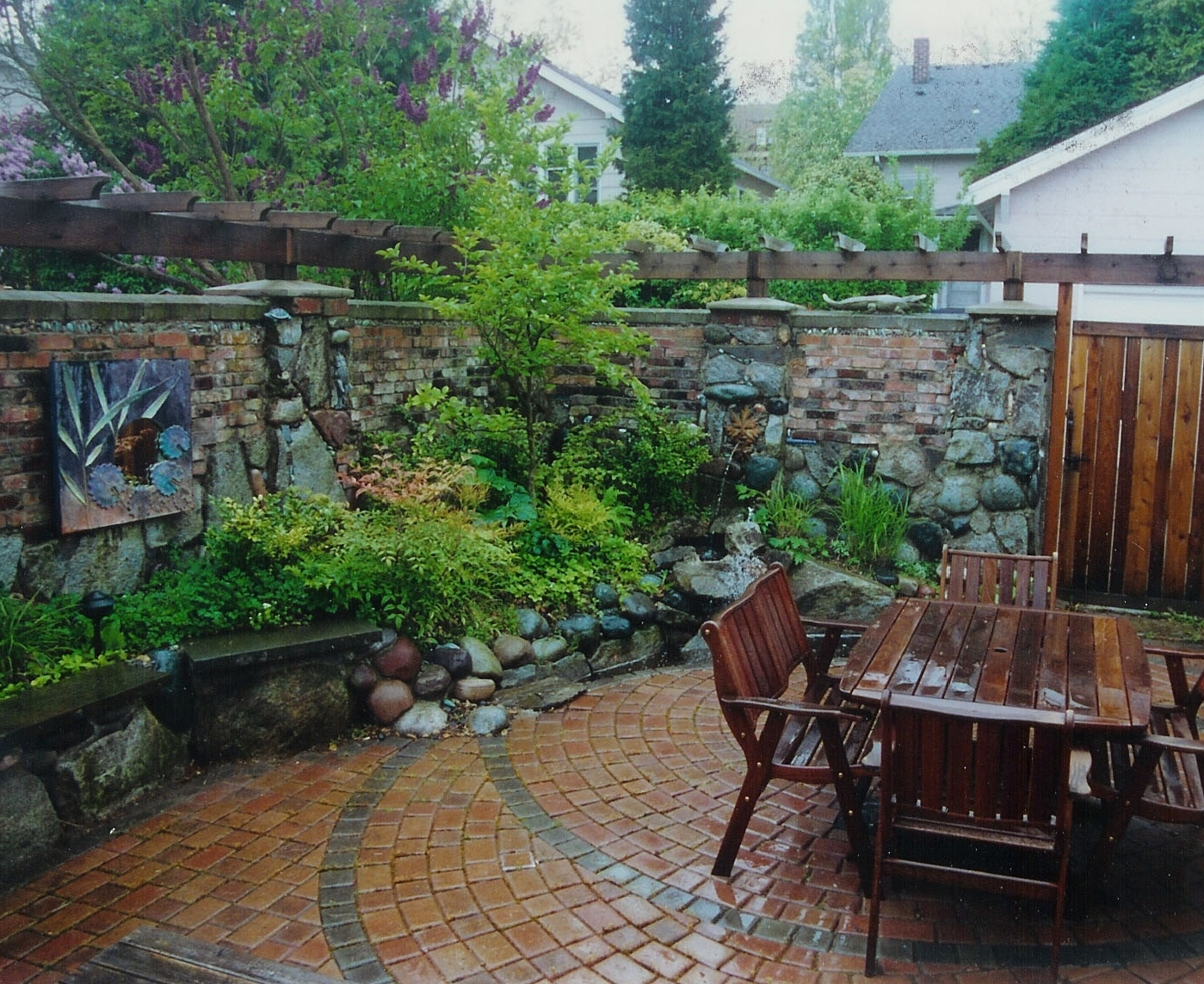 Brick wall designed by Kirkland Landscape Company, Environmental Construction